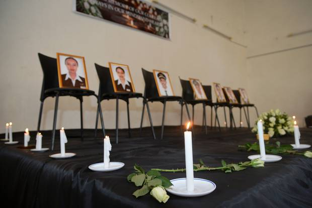 Framed photographs of seven crew members are displayed at a memorial service held by an association of Ethiopian airline pilots, in Addis Ababa. Photo / AP