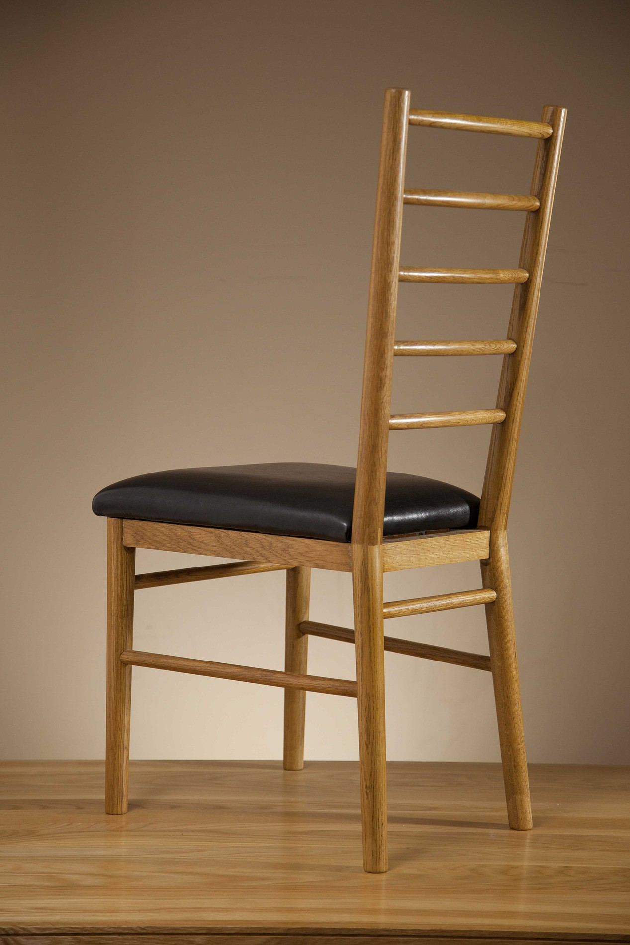 rustic dining chairs uk folding chair plans osaka solid oak and black leather