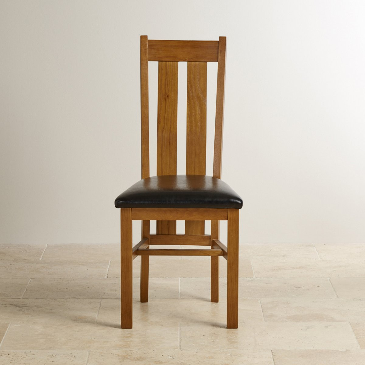rustic dining chairs uk low folding beach arched back chair in solid oak black leather