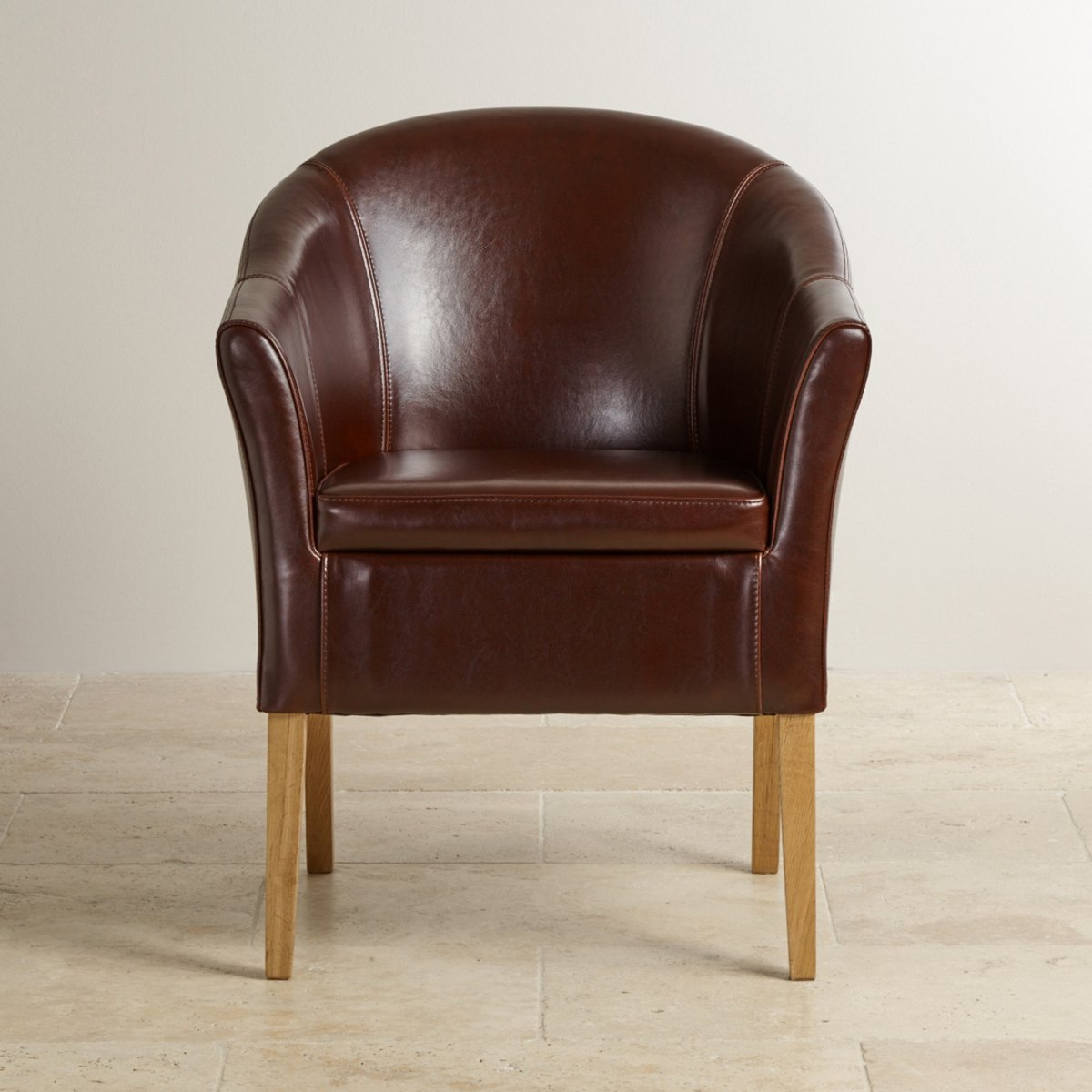 leather bucket chair acrylic dining chairs brown tub with solid oak legs