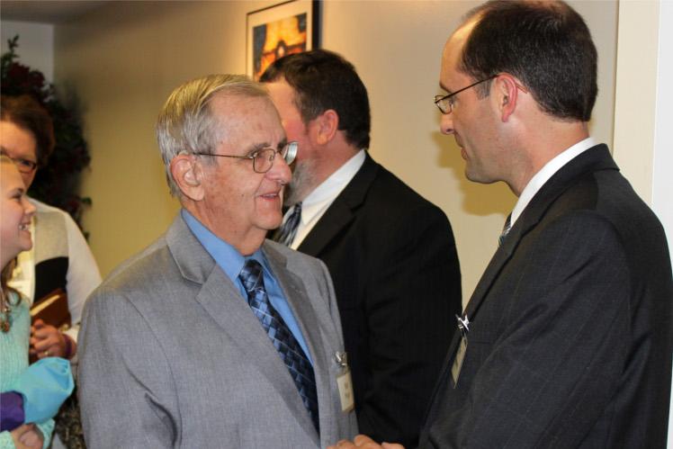 Pastor greeting member of congregation