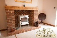 Modern brick fireplace with oak mantle beam (4926 ...