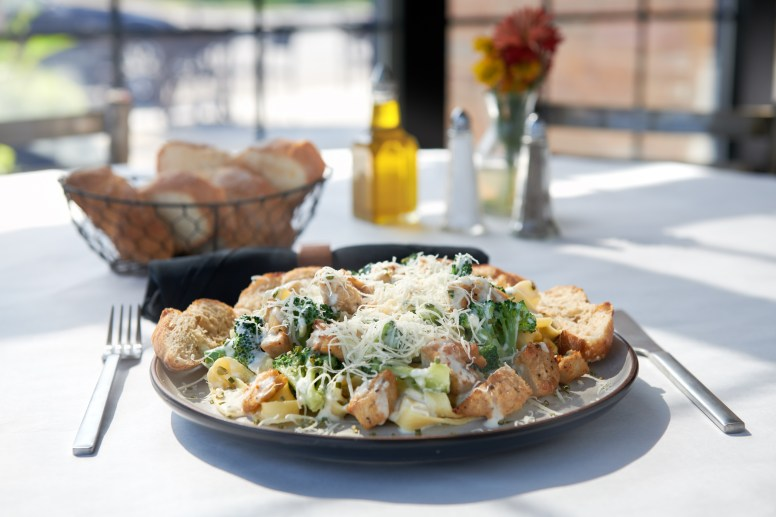 The chicken Caesar salad at Jim and Pete is made from romaine lettuce and topped with grilled chicken breast, parmesan cheese, croutons and creamy Caesar dressing.