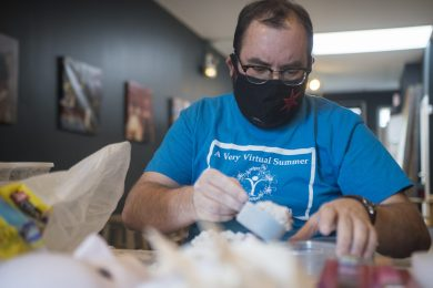 Technical Director Jeremiah Barr, of Chicago, packs materials for mask making at The Actors Garden on Lombard Avenue. | Alex Rogals/Staff Photographer