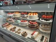 Well-lit cases showcase Pierre's Bakery offerings.