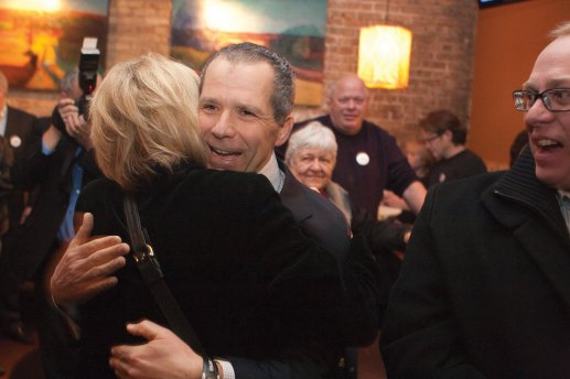 Anan Abu-Taleb hugs a supporter Tuesday night as he celebrated defeating John Hedges for the Oak Park village presidency. David Pierini/staff photographer