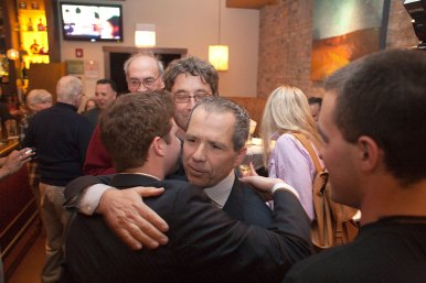 Anan Abu-Taleb hugs his son, Matt, during his victory party Tuesday night. David Pierini/staff photographer