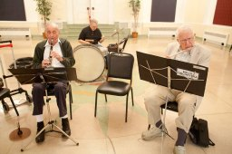 George Satala, left, Albert Hasselman and Jim Scherer practice with the rest of the Mills Orchestra at the Oak Park Arms on May 14.
