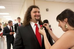 An attendant grabbed Jake Shadrake to pin on a boutonniere.