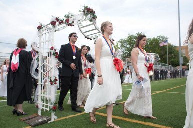 All 829 graduates processing on to the football field entered by walkiong under a rose-adorned trellis.