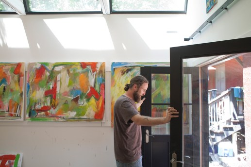 Artist Mike Hedges had a one-car garage converted into a studio that serves as storage, work and show space.