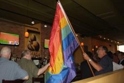 Jim Kelly raises the flag in celebration.