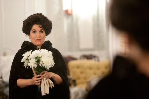 Christine Steyer of Oak Park takes a final look in the mirror before the start of a dress rehearsal for the Verismo Opera Theater performance of La Traviata. The award-winning soprano plays the lead role, Violetta Valery. (David Pierini/staff photographer)