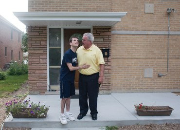 home away from home: Matt Herbstritt pats his father, Terry, outside his group home on Harvey Street in Oak Park. Terry Herbstritt is the development director for Parents Allied with Children and Teachers for Tomorrow, which recently opened the home for adults with autism. (DAVID PIERINI/Staff Photographer)