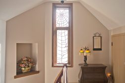 The Web he weaved: A common Zook touch is a spider web, usually incorporated into a leaded window, like this one on the second floor of Carol Bartels' house in River Forest. Zook believed spiders were the world's best architects. (DAVID PIERINI/Staff Photographer)