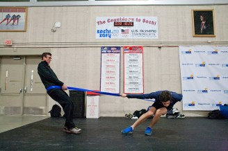 Lehman with his coach Jeff Klaiber use a resistance band to strengthen his crossovers in the turns. (David Pierini/staff photographer)