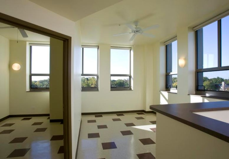 A typical apartment is open plan with 10-foot ceilings and tall windows that expand the small footprint.