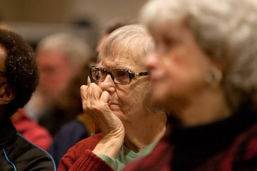 A woman in the crowd listens and takes notes. (David Pierini/staff photographer)