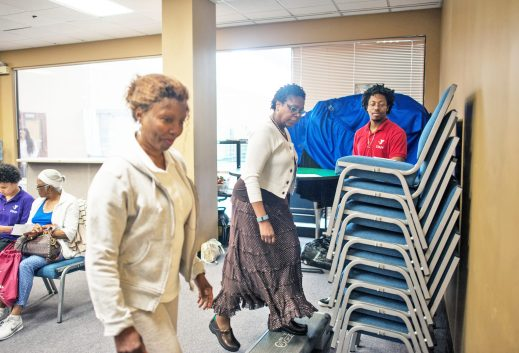 Harriette Fridge (l) and Helena Harris (r) take a step test to establish baseline fitness levels during the Health and Fitness Fair at the Living Word Christian Center.  WILLIAM CAMARGO/Staff photographer