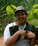Jennifer Baeza holds plants that a group of students planted on a recent trip.   Courtesy of Farther Foundation