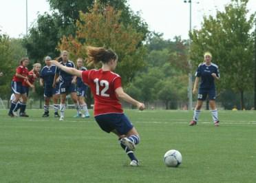 A female Chicago Edge Soccer Club player kicks the ball during a match. (Courtesy Chicago Edge Soccer Club