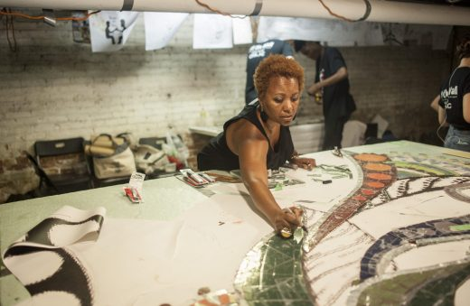 Carolyn Elaine, the lead artist for the mural to be installed under the viaduct at Austin Boulevard and Lake Street, works on the project in the basement of an Austin apartment building. The mural should go up in a few weeks. | WILLIAM CAMARGO/Staff Photographer