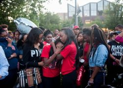 Tyanna Norman, Sims' girlfriend, is comforted by her sister Alexis during the Aug. 31 vigil. | William Camargo/Staff