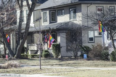 Flying the flag: Residents of the 600 block of Fair Oaks are flying rainbow flags and displaying anti-hate yard signs to make a statement about the 'hateful policies' of Pres. Donald Trump. Oak Park and River Forest High School grad Sarah Sugimoto, 19, said she wants to send a message that discrimination is not welcome in Oak Park. | WILLIAM CAMARGO/Staff Photographer