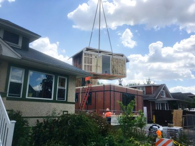 Modular units for 624 N. Taylor were built indoors at Hi-Tech Housing in Indiana and then lowered into place via crane onsite in Oak Park. | Image courtesy of downontaylor.weebly.com