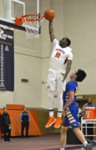 The Huskies' Isaiah Fuller, one of the best guards in the West Suburban Conference Silver Division, soars to the basket for an emphatic dunk. (Alexa Rogals/Staff Photographer)