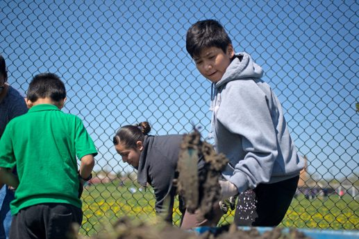 DIGGING IN THE DIRT: Neighbors and students began work at Chicago Farm Lab in the first weekend of May. Farm Lab organizer Marnie Ware says fundraising efforts are ongoing for the 2-acre urban farm.   Photo by Alexa Rogals