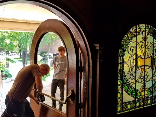 More Pleasant: (Top) Workers prepare to install a restored stained-glass window in the front door of Pleasant Home. | TIMOTHY INKLEBARGER/Contributor