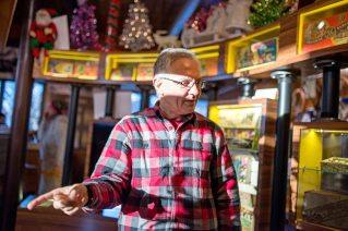 Jerry Ehrenberger works on finishing up his holiday exhibit on Nov. 14, at the Oak Park River Forest Museum on Lake Street in Oak Park. | Alexa Rogals/Staff Photographer