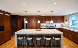 Oak Park architect Ted Nourie designed the kitchen and three-story renovation of the 1908 Edwin Ehrman home, an Arts & Crafts style home that houses three generations. (Mark Wright Photography)