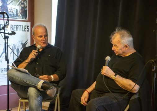 Dave Hoekstra, left, WGN Radio host, asks John Prine questions from the audience last Thursday, June 6, during a private event at Val's Halla Records in the Arts District in Oak Park. | ALEXA ROGALS/Staff Photographer