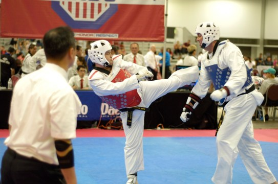 Andrey Rogachev (left/red & white gear), an Oak Park resident, executes a move during sparring match at the 2019 USA Taekwondo National Championships in Minneapolis. (Submitted Photo)