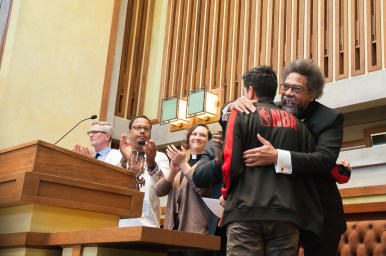 Cornel West, right, embraces Diego Amite on Saturday during a gathering at Unity Temple in Oak Park. | Shanel Romain