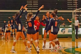 OPRF volleyball players get pumped during a match. The Huskies return the core of their lineup this season.   Courtesy Kelly Collins