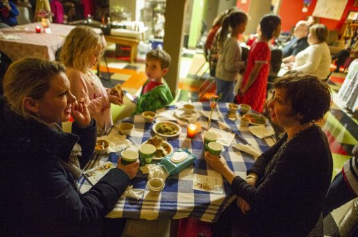 Fine dining: Christine O'Neill, left, and Holly Ashworth, both of Oak Park, chat over drinks and food prepared and served by their kids during Seed Cafe Night at Seed Montessori School. | ALEX ROGALS/Staff Photographer