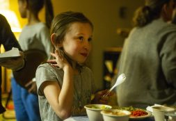 Rosie O'Neill, 8, of Oak Park, tries out the different food on Jan. 24, during a Seed Cafe Night at the Seed Montessori on Madison Street in Oak Park. | ALEX ROGALS/Staff Photographer