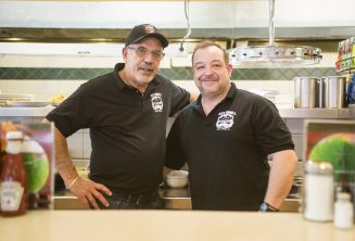 Owner Bill Loutos poses with son-in-law Pete Mourtokokis during the lunch time rush at Al's Grill on Madison Street and Wisconsin Avenue in Oak Park.   ALEX ROGALS/Staff Photographer