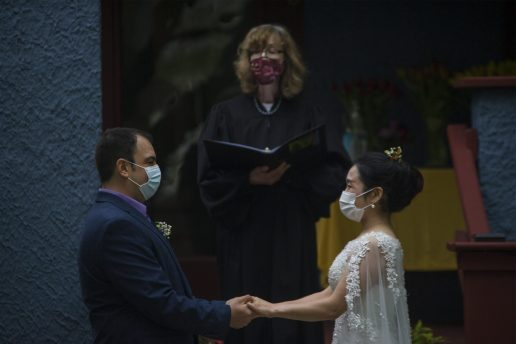 Pamela Meyerson marries the couple on Monday, May 18, 2020, during an outdoor wedding on Carpenter in Oak Park, Ill. | ALEX ROGALS/Staff Photographer