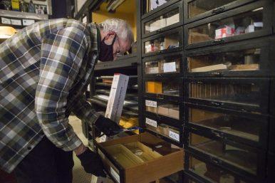 John Roberts goes through a drawer on Friday, May 22, 2020, at Pieritz Brothers on Ridgeland Avenue in Oak Park, Ill.   ALEX ROGALS/Staff Photographer