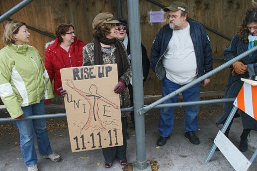 Promoting progress: Arts District supporters rallied in front of 201 Harrison St. last Friday.Photos by Marty Stempniak/Staff