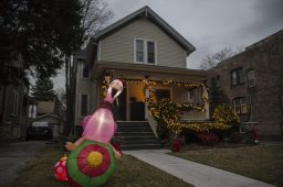 Along with holiday lights, a house also has an inflatable flamingo in their front yard on Thursday, Dec. 17, 2020, on the 200 block of South Clinton in Oak Park, Ill. | ALEX ROGALS/Staff Photographer