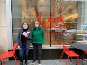 Susie Goldschmidt poses with Colleen Caulliez, co-owner of Lea French Street Food in Oak Park after purchasing gift cards on behalf of Byline Bank.