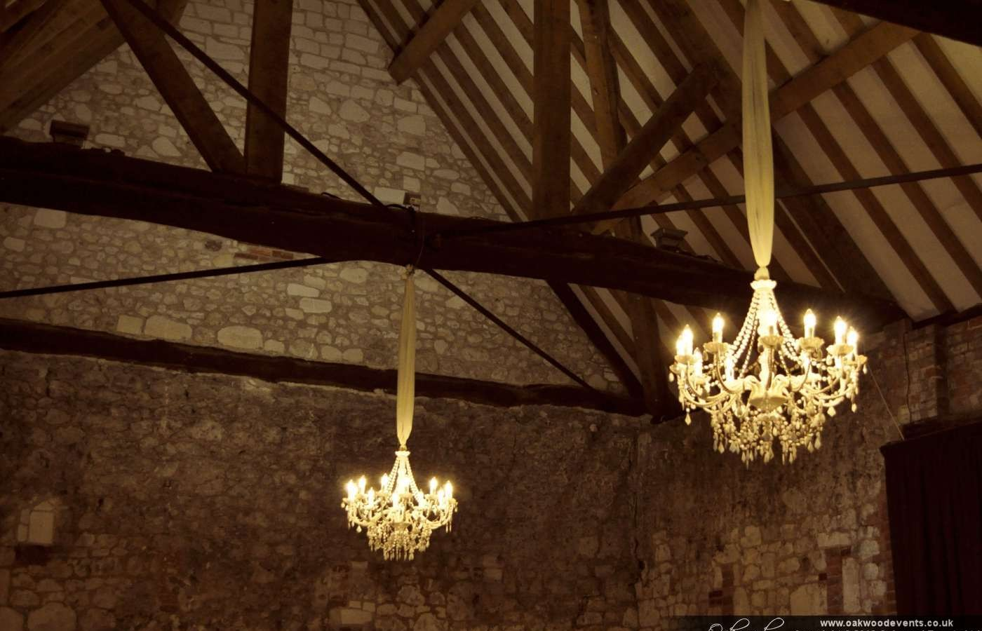 White Chandeliers For A Barn Wedding