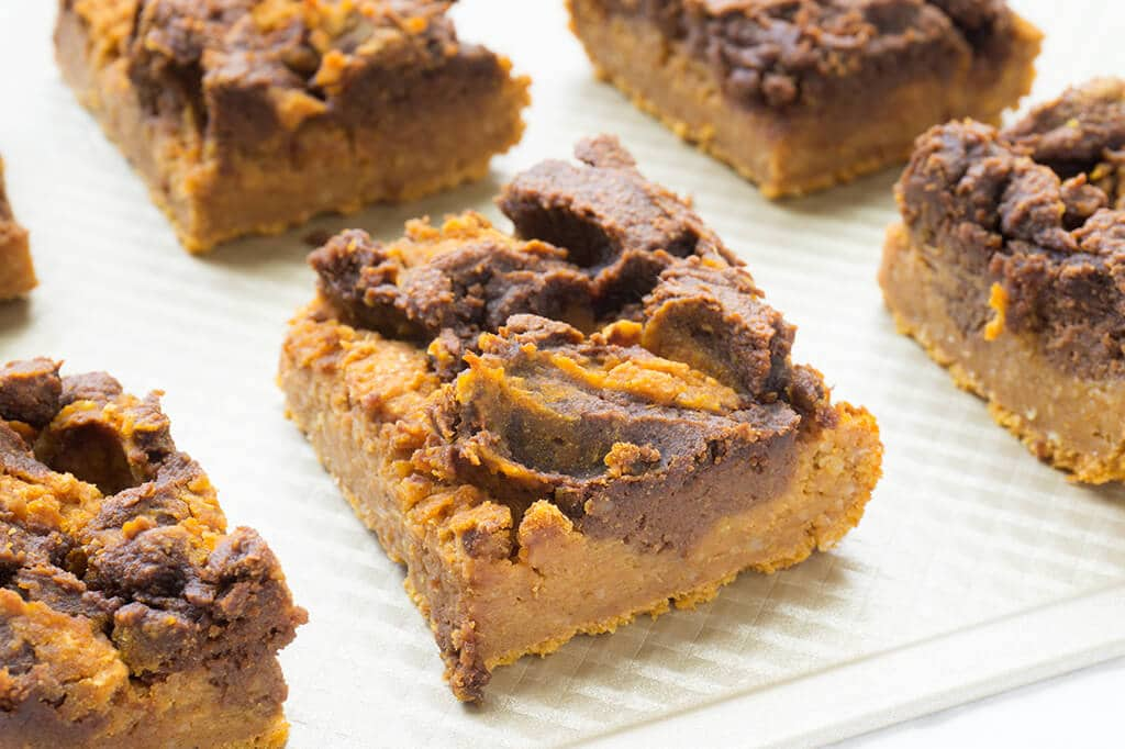 Vegan Pumpkin Pie Bars - squares in a line on baking sheet