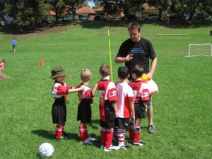 "Mal handing out medals to the U6 ""RaScaLs"" at the end of the 2009 season."