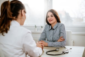 woman talking with doctor at gynecology appointment